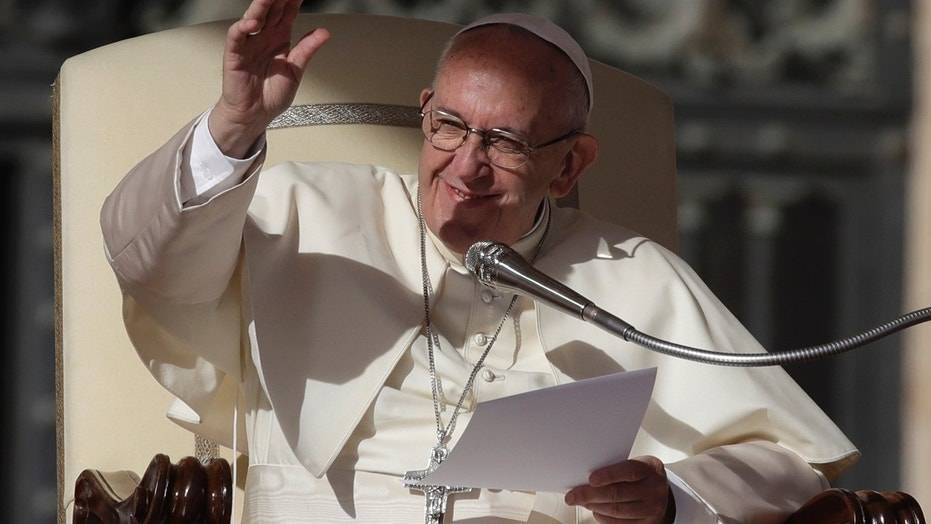 Oct. 25: Pope Francis acknowledges faithful during his weekly general audience, in St. Peter's Square. The Vatican reportedly approved an English-language translation of the exorcism rituals