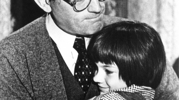 Gregory Peck embraces Mary Badham, 9, a Birmingham Alabama acting discovery who plays his daughter in ÒTo Kill a MockingbirdÓ  March 1963. (AP Photo)