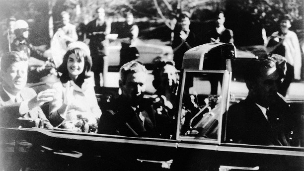 This image provided by the Warren commission, shows Warren Commission Exhibit No. 697, President John F. Kennedy at the extreme right on rear seat of his limousine during Dallas, motorcade on Nov. 22, 1963. His wife, Jacqueline, beside him, Gov. John Connally of Texas and his wife were on jump seats in front of the president. President Donald Trump is caught in a push-pull on new details of Kennedy's assassination, jammed between students of the killing who want every scrap of information and intelligence agencies that are said to be counseling restraint.  How that plays out should be known on Oct. 26, 2017, when long-secret files are expected to be released. (Warren Commission via AP)