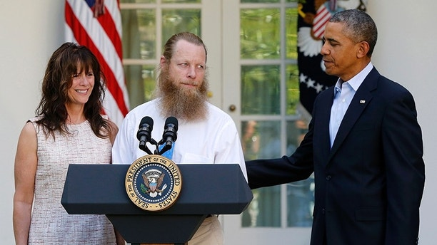"U.S. President Barack Obama (R) watches as Jami Bergdahl (L) and Bob Bergdahl talk about the release of their son, prisoner of war U.S. Army Sergeant Bowe Bergdahl, during a statement in the Rose Garden at the White House in Washington May 31, 2014. Obama, flanked by the parents of Army Sergeant Bowe Bergdahl, a U.S. soldier who is being released after being held for nearly five years by the Taliban, said in the White House Rose Garden on Saturday that the United States has an ""ironclad commitment"" to bring home its prisoners of war. REUTERS/Jonathan Ernst    (UNITED STATES - Tags: POLITICS MILITARY) - GM1EA610J6201"