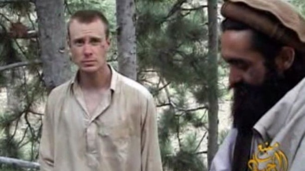 Dec. 8, 2010: This file image provided by IntelCenter shows a framegrab from a video released by the Taliban containing footage of a man believed to be Sgt. Bowe Bergdahl, left.
