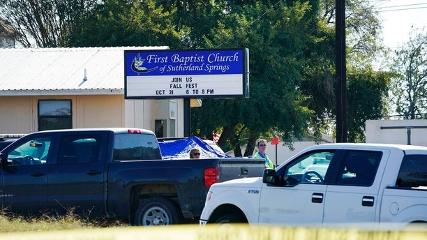 Law enforcement officers work in front of the First Baptist Church of Sutherland Springs after a fatal shooting, Sunday, Nov. 5, 2017, in Sutherland Springs, Texas. (AP Photo/Darren Abate)