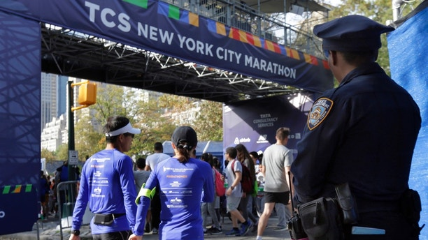 A New York City police office stands near the finish line of the New York City Marathon, in New York's Central Park, Friday, Nov. 3, 2017. New York City police say they're prepared with increased security for the marathon this weekend, days after eight people were killed not far from the World Trade Center in a terrorist attack when a man driving a rented truck mowed people down on a bicycle path. (AP Photo/Richard Drew)