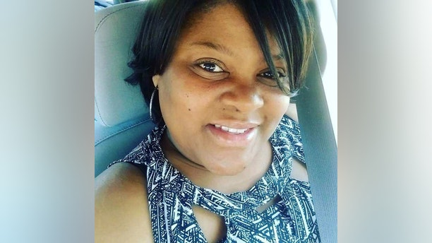 "This undated selfie provided by Heather Coggins shows her, a niece of Timothy Coggins. During a court hearing on Wednesday, Nov. 1, 2017, a Georgia prosecutor said Timothy Coggins, a black man, was killed because he had been ""socializing with a white female."" ""It was very difficult hearing some of the things today, and seeing the defendants was very difficult as well,"" said Heather Coggins, who sat in the courtroom. (Heather Coggins via AP)"