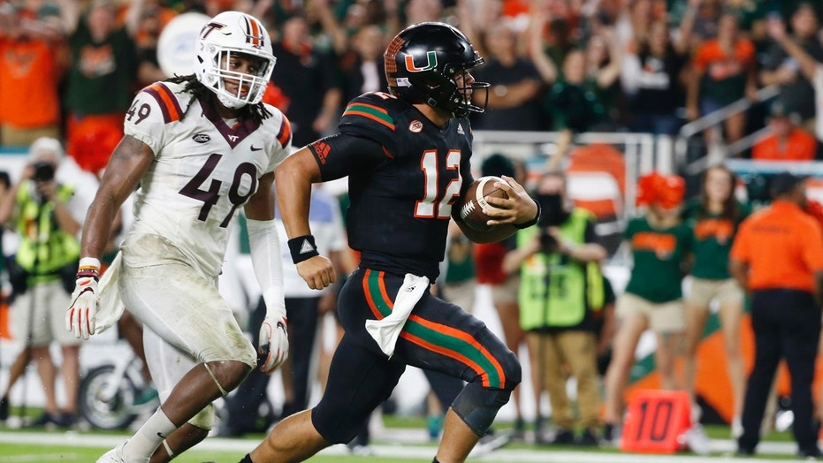 Miami quarterback Malik Rosier (12) runs for a touchdown against defense by Virginia Tech linebacker Tremaine Edmunds (49) during the second half of an NCAA College football game, Saturday, Nov. 4, 2017 in Miami Gardens, Fla. Miami defeated Virginia Tech 28-10. (