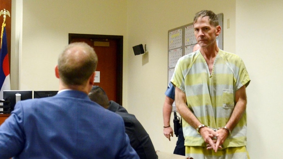 Scott Ostrem, 47, suspected of fatally shooting three people inside a suburban Denver Walmart, enters a courtroom in Brighton, Colo. on Monday.
