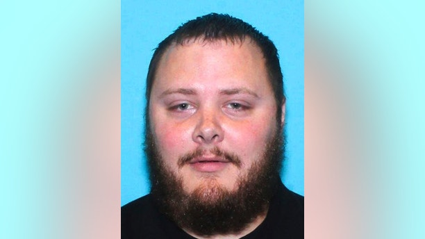 FILE - This undated file photo provided by the Texas Department of Public Safety shows Devin Kelley, the suspect in the shooting at First Baptist Church in Sutherland Springs, Texas, on Sunday, Nov. 5, 2017. A short time after the shooting, Kelley was found dead in his vehicle. Federal investigators say they are trying to get into Kelley's cellphone. The inability to access Kelley's phone highlights a longstanding frustration of the FBI, which said it has been unable to retrieve data from half the mobile devices it tried to access in less than a year. Technology companies have insisted they must protect customers' digital privacy. (Texas Department of Public Safety via AP, File)