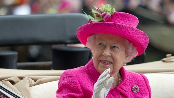 FILE - In this Thursday, June 22, 2017 file photo, Britain's Queen Elizabeth II waves to the crowd as she arrives by open carriage into the parade ring on the third day of the Royal Ascot horse race meeting, which is traditionally known as Ladies Day, in Ascot, England. (AP Photo/Alastair Grant, File)