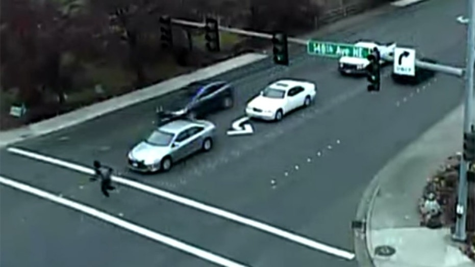 The moment before a man collided with an SUV at an intersection in Bellevue, Wash.