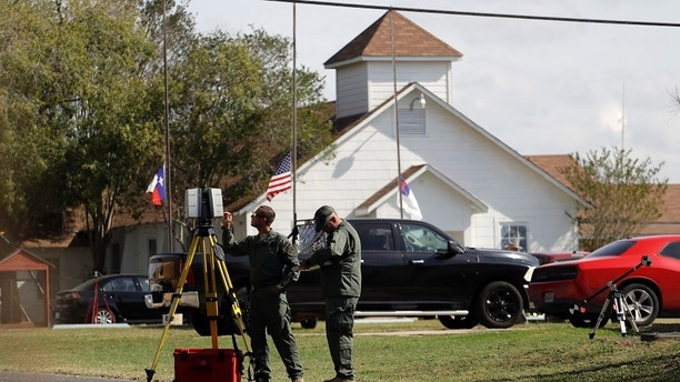 Law enforcement officials continue to investigate the scene of a shooting at the First Baptist Church of Sutherland Springs, Tuesday, Nov. 7, 2017, in Sutherland Springs, Texas. A man opened fire inside the church in the small South Texas community on Sunday, killing more than two dozen and injuring others. (AP Photo/Eric Gay)