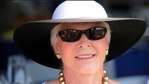 In this June 22, 2013 photo, Lois Colley attends a match at the Mashomack Polo Club in Pine Plains, N.Y. Lois Colley, 83, a socialite known to mingle among New York's most powerful families, and the wife of a millionaire McDonald's franchisee, was found dead in the couple's North Salem, N.Y., hilltop estate Monday, Nov. 9.   (AP Photo/Peter T. Michaelis)