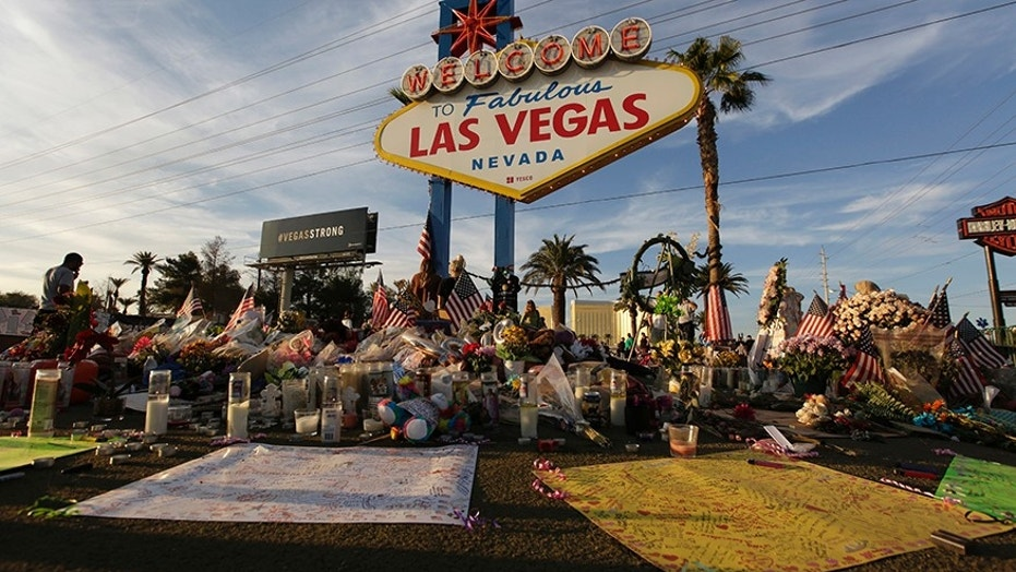 People visit a makeshift memorial on Oct. 16 for victims of the mass shooting in Las Vegas.