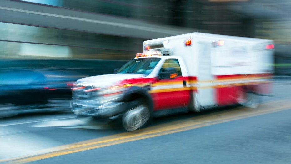 An ambulance speeds to an emergency scene in New York City.
