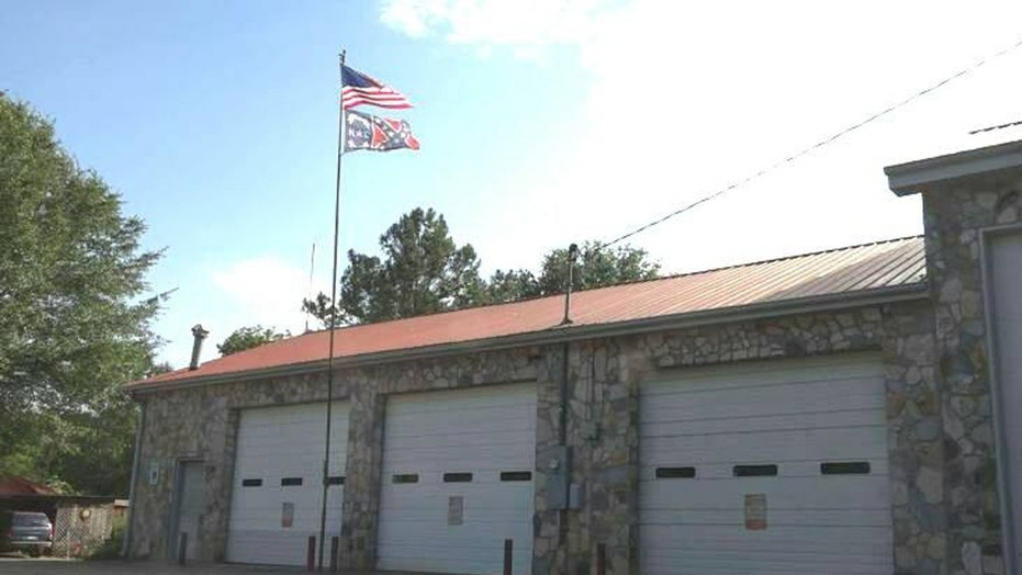 The Uwharrie Volunteer Fire Department is seen in Troy, North Carolina flying a Confederate flag.