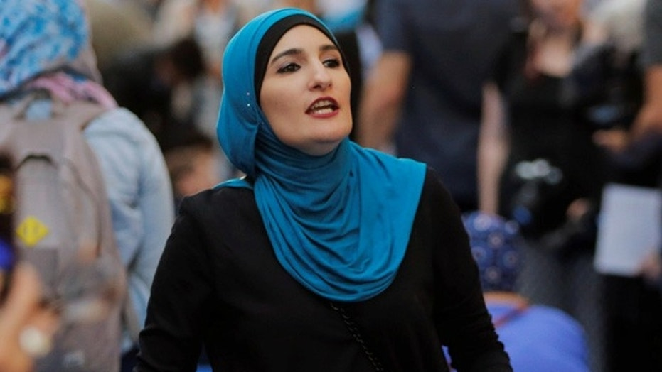 Activist Linda Sarsour prepares for the beginning of a demonstration outside of Trump Tower.