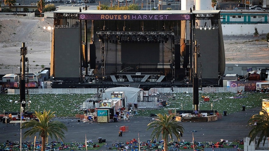 In this Oct. 3, 2017, file photo, debris litters a concert festival grounds after a mass shooting in Las Vegas.