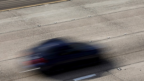 Cars travel on roads lacking painted freeway lane markers on Interstate highway 5 in San Diego, California February 10, 2016. Picture taken February 10. To match Insight AUTOS-AUTONOMOUS/INFRASTRUCTURE     REUTERS/Mike Blake - GF10000365353