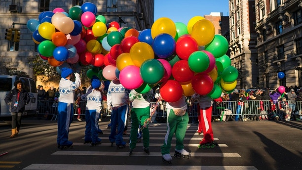 Participants take their place along the parade route before the Macy's Thanksgiving Day Parade begins in New York, Thursday, Nov. 23, 2017. (AP Photo/Craig Ruttle)