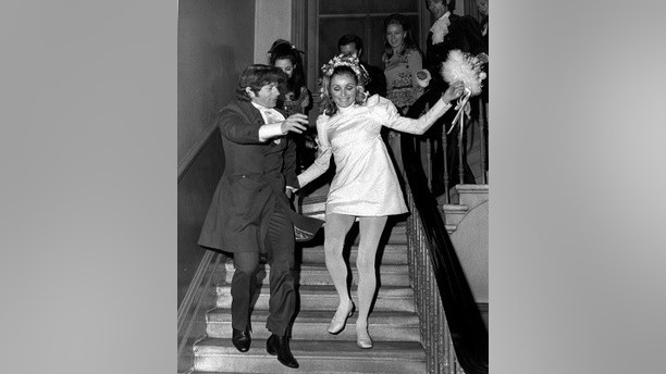 "FILE - In this Jan. 20, 1968, file photo, American actress Sharon Tate and Polish born film director Roman Polanski skip downstairs after their wedding at Chelsea Register Office in London. The 26-year-old former model gained film stardom after appearing in 1966's ""Valley of the Dolls."" A year later, she starred in ""The Fearless Vampire Killers,"" directed by her future husband, Roman Polanski. At the time of her death, Tate was 8 1/2 months pregnant with Polanski's son. She pleaded with the killers to spare the life of her unborn child. (AP Photo/Eddie Worth, File)"