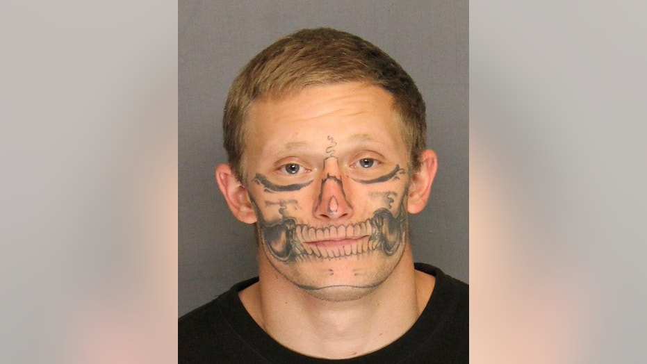 Skull Drama Face Tattoo: Blending In With The Crowd