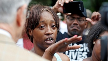"Diamond Reynolds recounts the incidents that led to the fatal shooting of her boyfriend Philando Castile by Minneapolis area police during a traffic stop on Wednesday, at a ""Black Lives Matter"" demonstration in front of the Governor's Mansion in St. Paul, Minnesota, U.S., July 7, 2016.  REUTERS/Eric Miller   - S1AETOFYLBAA"