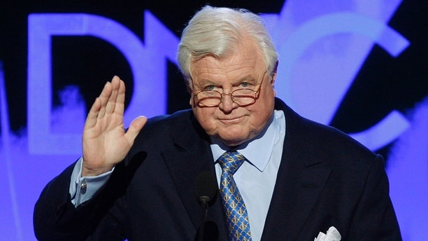 U.S. Senator Ted Kennedy (D-MA) gestures as he addresses the convention after a tribute to his life and career was presented at the 2008 Democratic National Convention in Denver, Colorado, August 25, 2008. U.S. Senator Barack Obama (D-IL) is expected to accept the Democratic presidential nomination at the convention on August 28. REUTERS/Mike Segar  (UNITED STATES) US PRESIDENTIAL ELECTION CAMPAIGN 2008 (USA) - GM1E48Q0RJF01