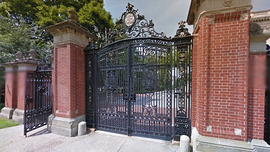 A photograph viewed by Brown University's student newspaper showed new swim and dive team members stripped down to underwear or swim suits and photographed in front of the university's Van Wickle Gates, according to The Associated Press.