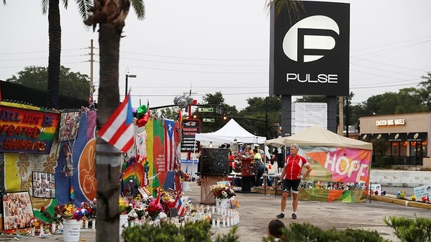 A guest walks through the parking lot outside the Pulse Nightclub on the first anniversary of the shooting, in Orlando, Florida, USA. US, June 12, 2017. REUTERS / Scott Audette - RC1C81D7DF00