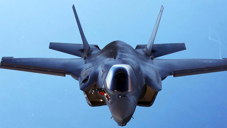 FILE: A U.S.Marine Corps F-35B joint strike fighter jet conducts aerial maneuvers during aerial refueling training over the Atlantic Ocean.