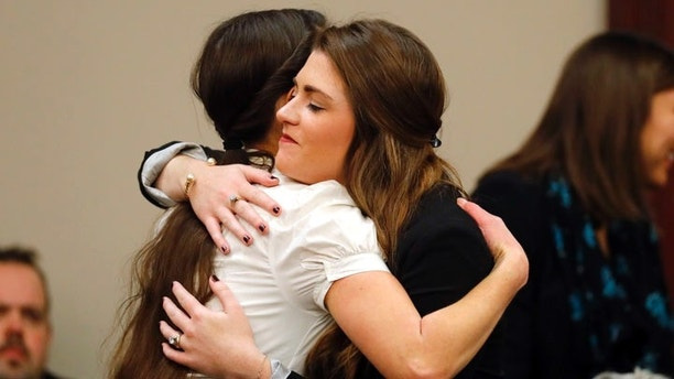 Rachael Denhollander, left, hugs Larissa Boyce, after Dr. Larry Nassar appeared in court for a plea hearing in Lansing, Mich., Wednesday, Nov. 22, 2017. Nasser, a sports doctor accused of molesting girls while working for USA Gymnastics and Michigan State University pleaded, guilty to multiple charges of sexual assault and will face at least 25 years in prison.(AP Photo/Paul Sancya)