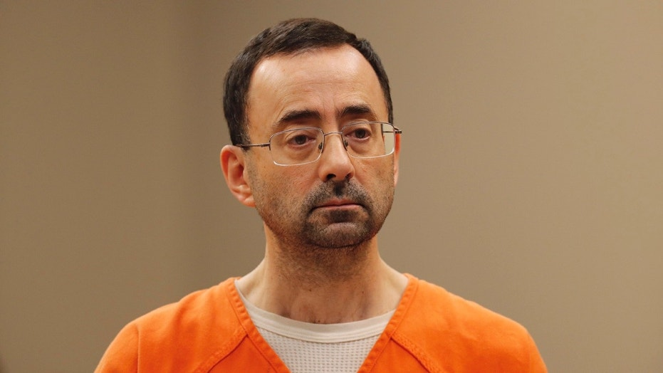 Dr. Larry Nassar, 54, appears in court for a plea hearing in Lansing, Mich.