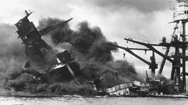 The battleship USS Arizona sinks after being hit by a Japanese air attack on Pearl Harbor, Hawaii, December 7, 1941. Picture taken December 7, 1941.    The U.S. National Archives/Handout via Reuters  ATTENTION EDITORS - THIS IMAGE WAS PROVIDED BY A THIRD PARTY. EDITORIAL USE ONLY - RC156189BC80