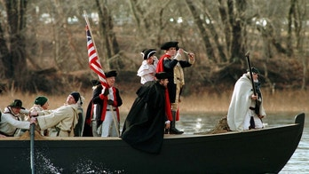 General George Washington, portrayed by Bob Gerenser, 43, of New Hope, Pennsylvania, (second from right) crosses the Delaware River with his troops to Trenton, New Jersey, from the Washington Crossing Historic Park in Pennsylvania, December 25. This year's reenactment marks the 221st anniversary of the crossing which led to the victory at Trenton during the Revolutionary War. By crossing the ice-filled Delaware River on Christmas night, 1776, Washington led a surprise attack on the Hessian Troops in Trenton and changed the course of events in the war. blj/Photo by Barbara L.