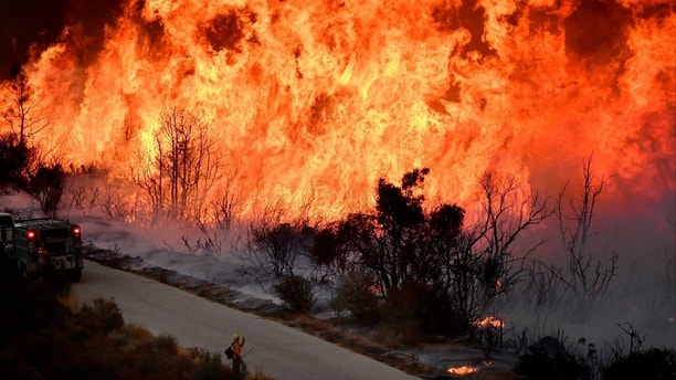 Fire fighters attack the Thomas Fire's north flank with backfires as they continue to fight a massive wildfire north of Los Angeles, near Ojai , California, U.S., December 9, 2017.  REUTERS/Gene Blevins     TPX IMAGES OF THE DAY - RC1A69A86C20