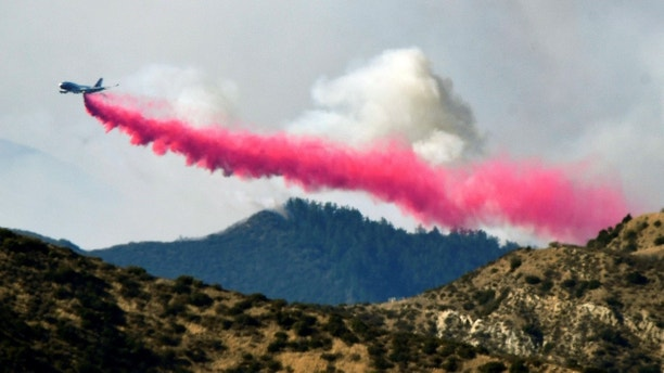 An aircraft drops fire retardant on the Thomas Fire , a wildfire in Fillmore, California, U.S., December 8, 2017.      REUTERS/Gene Blevins - RC1143AF1A10