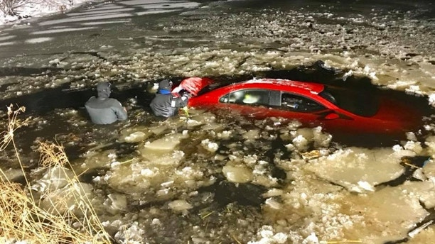 Man in vehicle sinking in icy pond is saved by first responders