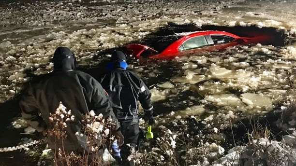 MA driver rescued from auto quickly sinking into icy pond