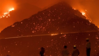 Firefighters monitor the Thomas fire as it burns through Los Padres National Forest near Ojai, Calif., on Friday, Dec. 8, 2017. (AP Photo/Noah Berger)