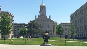 School mascot Herky the Hawk stands in front of the Old Capitol Museum at the University of Iowa, in Iowa City, Iowa, U.S. May 22, 2016.Officials at the university continue to try to determine the extent of cheating that took place this year and involved at least 30 students who allegedly hired imposters to do their coursework.  To move with Special Report  COLLEGE-CHEATING/IOWA       REUTERS/Koh Gui Qing - RTSFXD0
