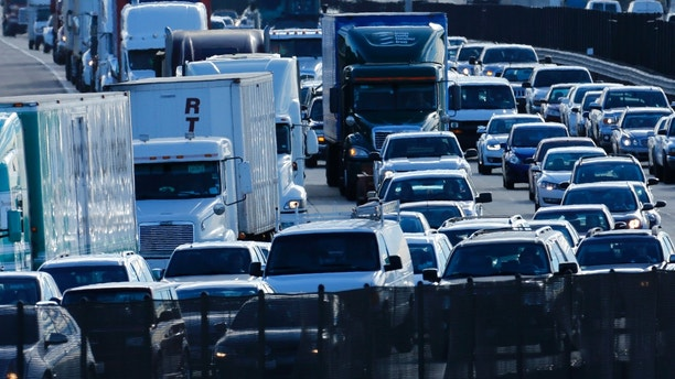 Automobile traffic backs-up as it travels  north from San Diego to Los Angeles along Interstate Highway 5 in California December 10, 2013. 