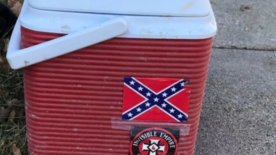"A worker lost his job after his cooler with ""offensive"" Ku Klux Klan and Confederate flag stickers was spotted, city officials said."