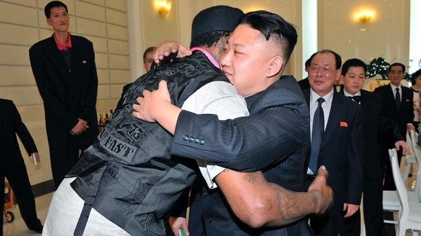 North Korean leader Kim Jong-Un and former NBA basketball player Dennis Rodman (front L) hug in Pyongyang in this undated picture released by North Korea's KCNA news agency on March 1, 2013. KCNA reported that a mixed basketball game of visiting U.S. basketball players and North Korean players was held at Ryugyong Jong Ju Yong Gymnasium on February 28, 2013.     REUTERS/KCNA (NORTH KOREA - Tags: POLITICS SPORT BASKETBALL TPX IMAGES OF THE DAY) ATTENTION EDITORS - THIS PICTURE WAS PROVIDED BY A THIRD PARTY. REUTERS IS UNABLE TO INDEPENDENTLY VERIFY THE AUTHENTICITY, CONTENT, LOCATION OR DATE OF THIS IMAGE. THIS PICTURE IS DISTRIBUTED EXACTLY AS RECEIVED BY REUTERS, AS A SERVICE TO CLIENTS. QUALITY FROM SOURCE. NO THIRD PARTY SALES. NOT FOR USE BY REUTERS THIRD PARTY DISTRIBUTORS - GM1E9310WHR01