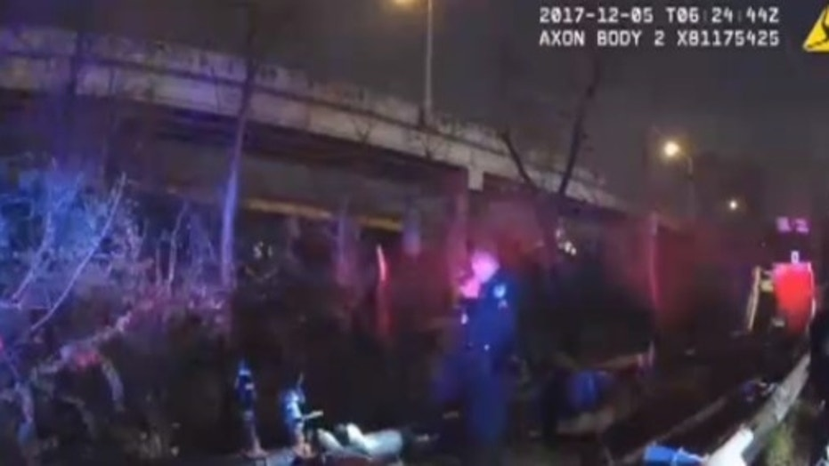 A truck driver who bolted as police in Kentucky were arresting him somehow survived after he plummeted off a 40-foot overpass — and then apparently kept trying to evade the cops.
