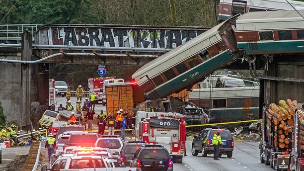 Cars from an Amtrak train that derailed lie spilled onto Interstate 5, Monday, Dec. 18, 2017, in DuPont, Wash. The Amtrak train making the first-ever run along a faster new route hurtled off the overpass Monday near Tacoma and spilled some of its cars onto the highway below, killing several people, authorities said. (Peter Haley/The News Tribune via AP)
