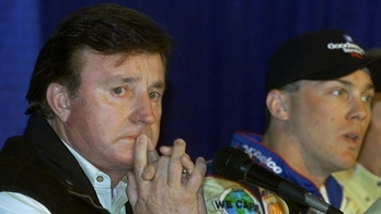 Owner of the Dale Earnhardt, Sr. number three car Richard Childress (L) fights back tears during a press conference as newly introduced driver Kevin Harvick answers questions after being introduced at North Carolina Raceway in Rockingham, North Carolina on February 23, 2001. Earnhardt Sr. died on the final lap at the Daytona 500 on February 18, 2001.