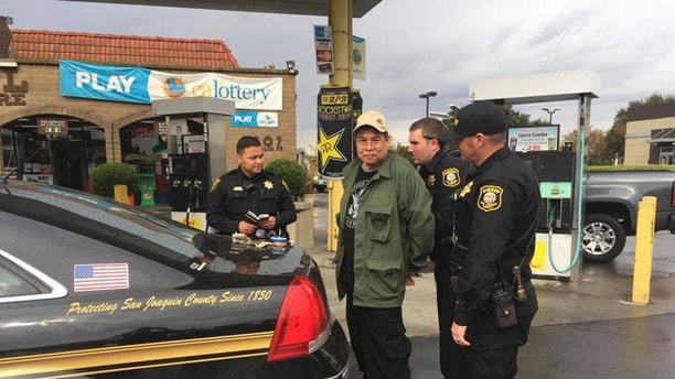 "FILE - This Wednesday, Nov. 15, 2017 file photo provided by the San Joaquin County Sheriff's office shows escaped patient Randall Saito being arrested in Stockton, Calif. Saito, who escaped from a psychiatric hospital in Hawaii, was captured as the result of a tip from a taxi cab driver. Saito's next hearing is scheduled on Monday, Nov. 27, 2017, afternoon in Stockton, Calif. Hawaii's attorney general called it a ""further arraignment"" and said Saito will ""have the choice to admit his identity and agree to extradition back to Hawaii, or to contest extradition."" (San Joaquin County Sheriff's Office via AP, File)"