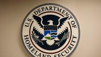U.S. Department of Homeland Security emblem is pictured at the National Cybersecurity & Communications Integration Center (NCCIC) located just outside Washington in Arlington, Virginia September 24, 2010. U.S. national security planners are proposing that the 21st century's critical infrastructure -- power grids, communications, water utilities, financial networks -- be similarly shielded from cyber marauders and other foes. The ramparts would be virtual, their perimeters policed by the Pentagon and backed by digital weapons capable of circling the globe in milliseconds to knock out targets.  To match Special Report  USA-CYBERWAR/          REUTERS/Hyungwon Kang   (UNITED STATES - Tags: CRIME LAW SCI TECH POLITICS) - RTXT2S4