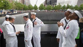 Sailors take in the view from the North Pool at the National September 11 Memorial, Friday, May 26, 2017, in New York. Approximately 3,700 Sailors, Marines and Coast Guardsmen partake in the weeklong Fleet Week celebration. (AP Photo/Mary Altaffer)