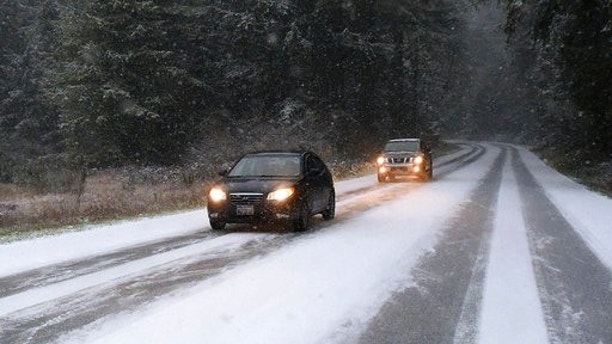 Motorists drive near Yelm, Wash., Sunday, Dec. 24, 2017. Snow, sleet and freezing rain is making holiday travel challenging in Washington state, Oregon and Idaho. The National Weather Service warned Portland Sunday afternoon that drivers should expect deteriorating road conditions through the day. (Steve Bloom/The Olympian via AP)