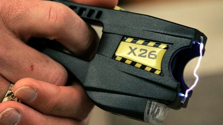 A Taser X26 stun gun is displayed at the Oakland County Sheriff's Office in Pontiac, Mich., Dec. 12, 2006.